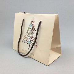 Beige paper gift bag Merry Christmas with rope handles 220+100x180mm
