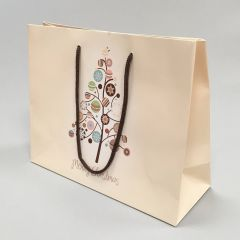 Beige paper gift bag Merry Christmas with rope handles 300+110x240mm